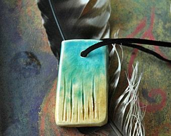 turquoise and gold ceramic pendant