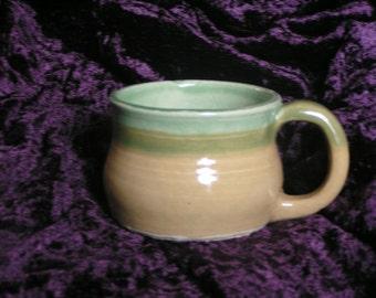 Hand-made pottery mug