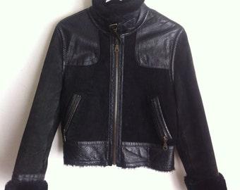 Black fur men's jacket, size medium.
