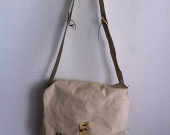 Beige handmade large shoulder bag on a long strap, a bag made of genuine leather.