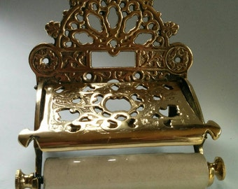Polished brass Victorian style toilet roll holder