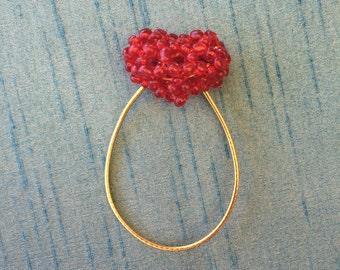Red, man made diamond balls, heart shaped hair tie.
