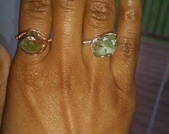 Peridot wrapped rings