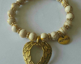 White and gold mother's memorial bracelet