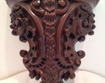 Ornately carved wooden wall shelf