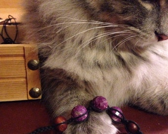 Purple beaded black hemp bracelet
