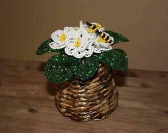 White violet, handmade beaded flower in decorative handmade basket, home decor