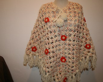 Off white poncho and its florets
