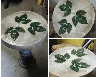 Beautiful and unique, hand-crafted concrete table/indoor or outdoor decor.