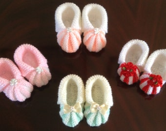 Hand-knitted striped baby shoes with embellishment