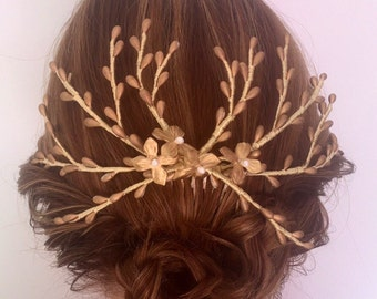 Bridal headpiece with branches of pistils and flowers.