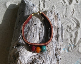 Leather bracelet with three lampwork beads