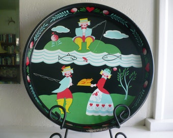Round black metal tray with whimsical Scandinavian style folk art, 13 1/2 inches, vintage