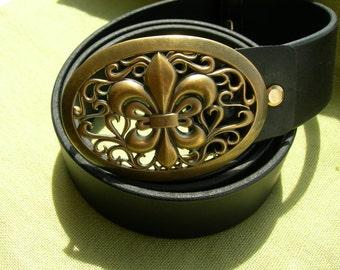 Leather belt with buckle. Fleur-de-Lis. Royal symbol. Bronze buckle. Medieval symbol.
