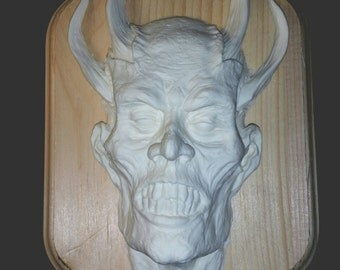 Old Scratch relief resin blank cast with wood base