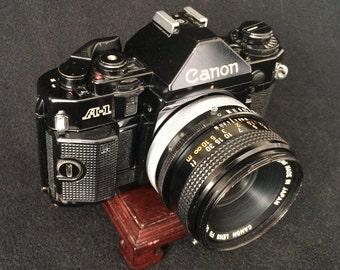 Canon A-1 35mm Film SLR Camera w/Canon FD F1.8 Lens and Sunpak Flash