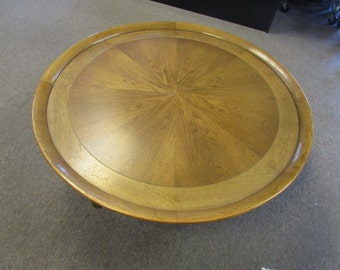 Mid century modern round coffee table. Made by Tomlinson. 40x16