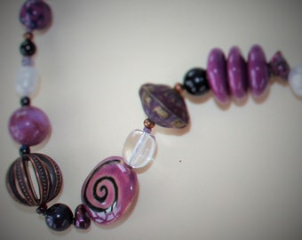 Kazuri bead necklace, purple with antiqued brass beads and toggle clasp