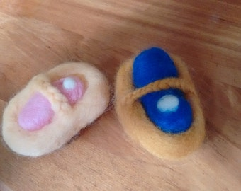 Needle felted baby in cradle
