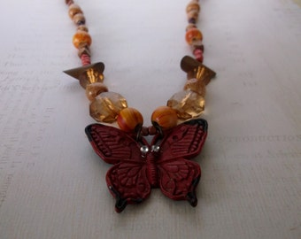 Butterfly Necklace, Metal Butterfly Pendant and Beaded Necklace, Rust colored metal butterfly neckace