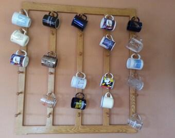 Wall mount wooden mug rack.