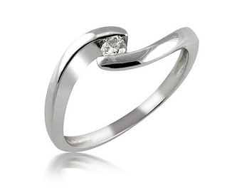 Ring white or yellow, sensual and luxurious gold with a diamond 0.10 CT