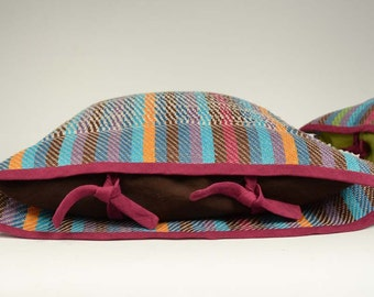 Handwoven cushion of linen. Weaving many-coloured and dark brown. One of a kind and original weaving.