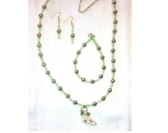 Antique drop leaf pendant in goldtones and green stones