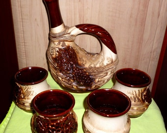 Original exclusive ceramics wine set. Decanter and four cups