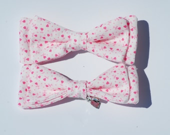 Small clip-on bows (pink heart pattern)