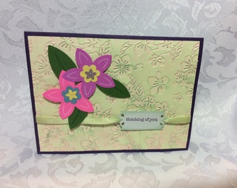 A Think of You Hand Made Card with Embossed Front and Pink and Purple Flowers