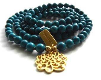 Handmade Necklace Turquoise with Flower and Karma Charm