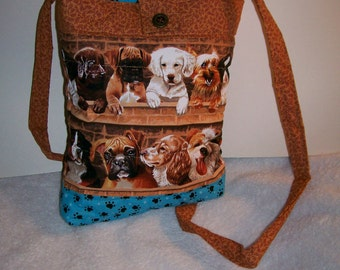 Puppies in a row march across this tablet  or reader bag.  Cute purse for everyday use, too.  ip303pr