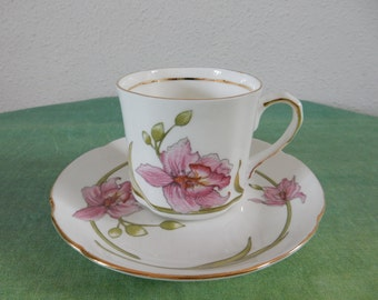 Cup and saucer with pink flower
