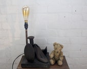 handcrafted and repurposed  antique cast iron hobbing foot and shoe form lamp