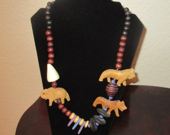 Vintage Wooden African Carved Necklace with genuine shell and gemstones. Includes Lion, elephant & hyena plus various beads. screw close