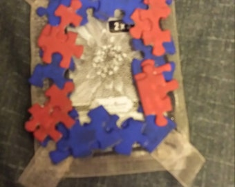 Red and blue painted puzzle piece picture frame