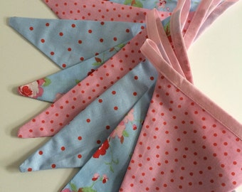 Vintage look handmade bunting, including floral flags & flags with polka dots made from pink, blue and floral Rosali cotton fabric