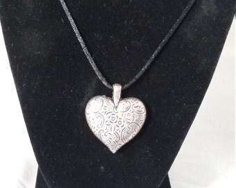 pretty silver heart pendant on Black cord