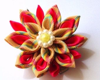 red and beige kanzashi flowers.