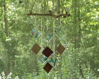 Handcrafted Fused Stained Glass wind chimes hanging from Driftwood.