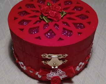 Red and gold round jewellery boxes