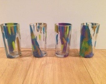 Set of four abstract decorated glasses.