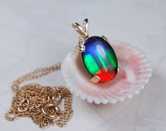 Rare and gorgeous top AA grade ammolite in yellow gold.