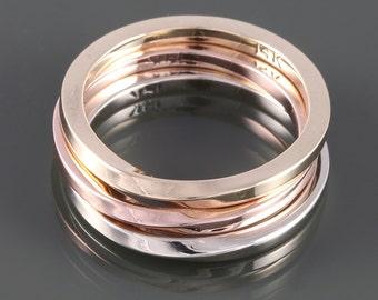 Set of Three Gold Mobius Rings: Solid 14 Karat Rose, Yellow, and White Gold