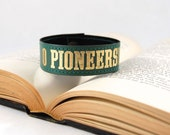 O Pioneers - Book Spine Bracelet - made from recycled vintage book by Rebound Designs