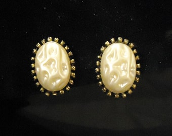 Gold Metal and Plastic Pearly Beige Cream Off White Colored Oval Shaped Screw Back Earrings with Gold Detailed Edging