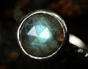 Round Labradorite gemstone in sterling silver ring with heavily textured and oxidized silver band