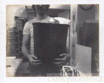 Vintage photo Abstract Polaroid Man CArrying Garbage Trash Bucket Random snapshot