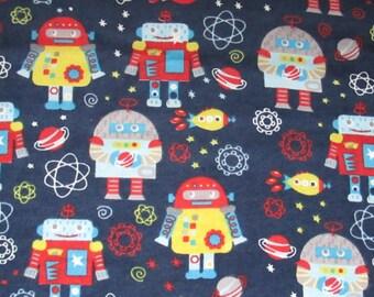 Cotton flannel - robots - rocket ship - planets - stars on navy - 1 yard